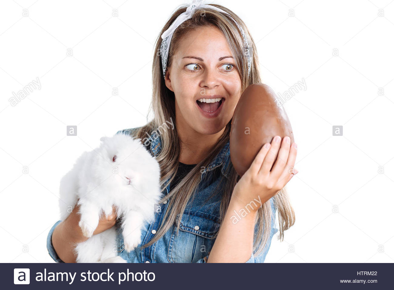 Happy woman holding big chocolate Easter egg with bunny Stock ...