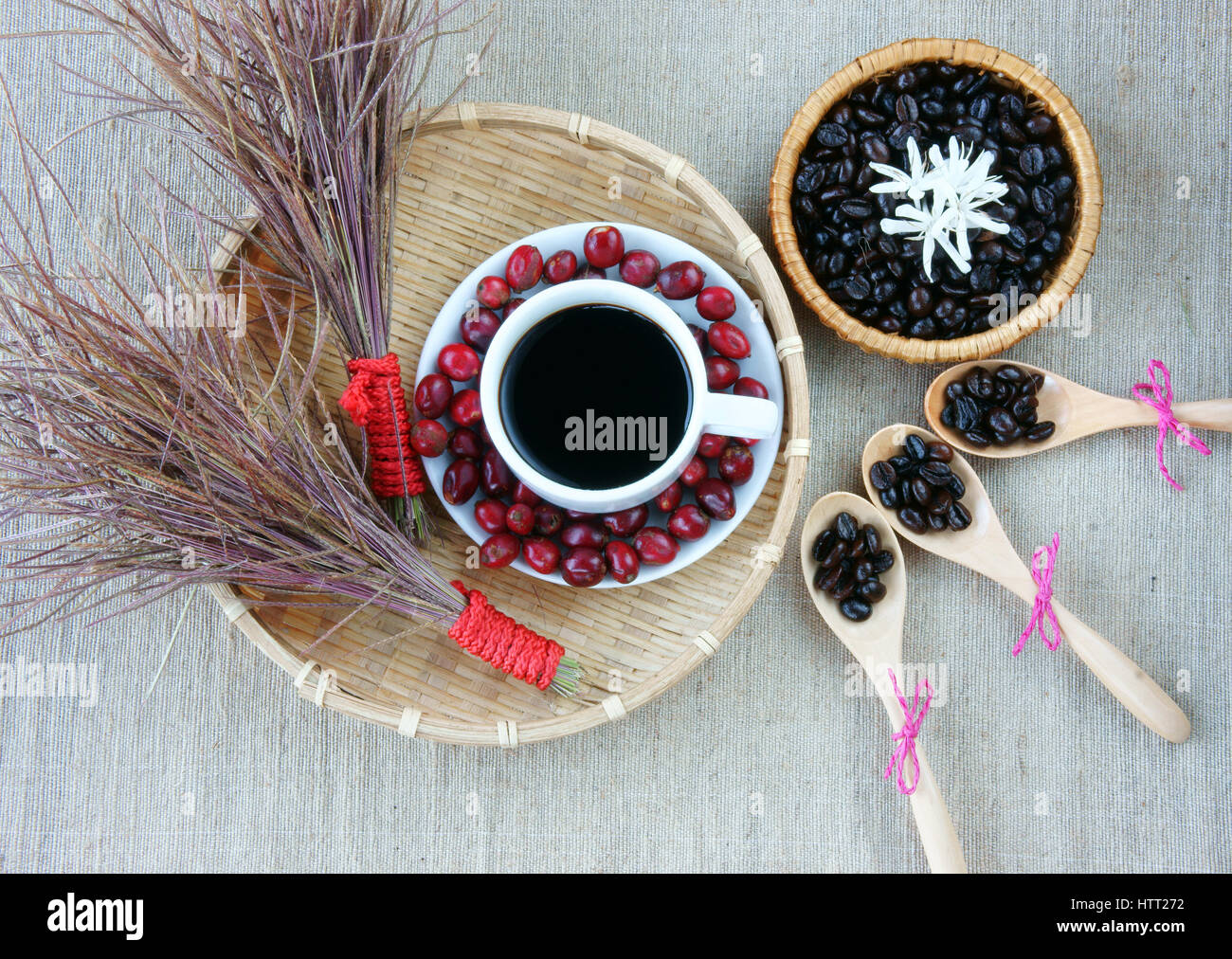 harmony creative for decor from coffee bean cup of black cafe ripe berries basket of roasted cafe bean white flower wooden spoon set up on sac - Black Cafe Decor