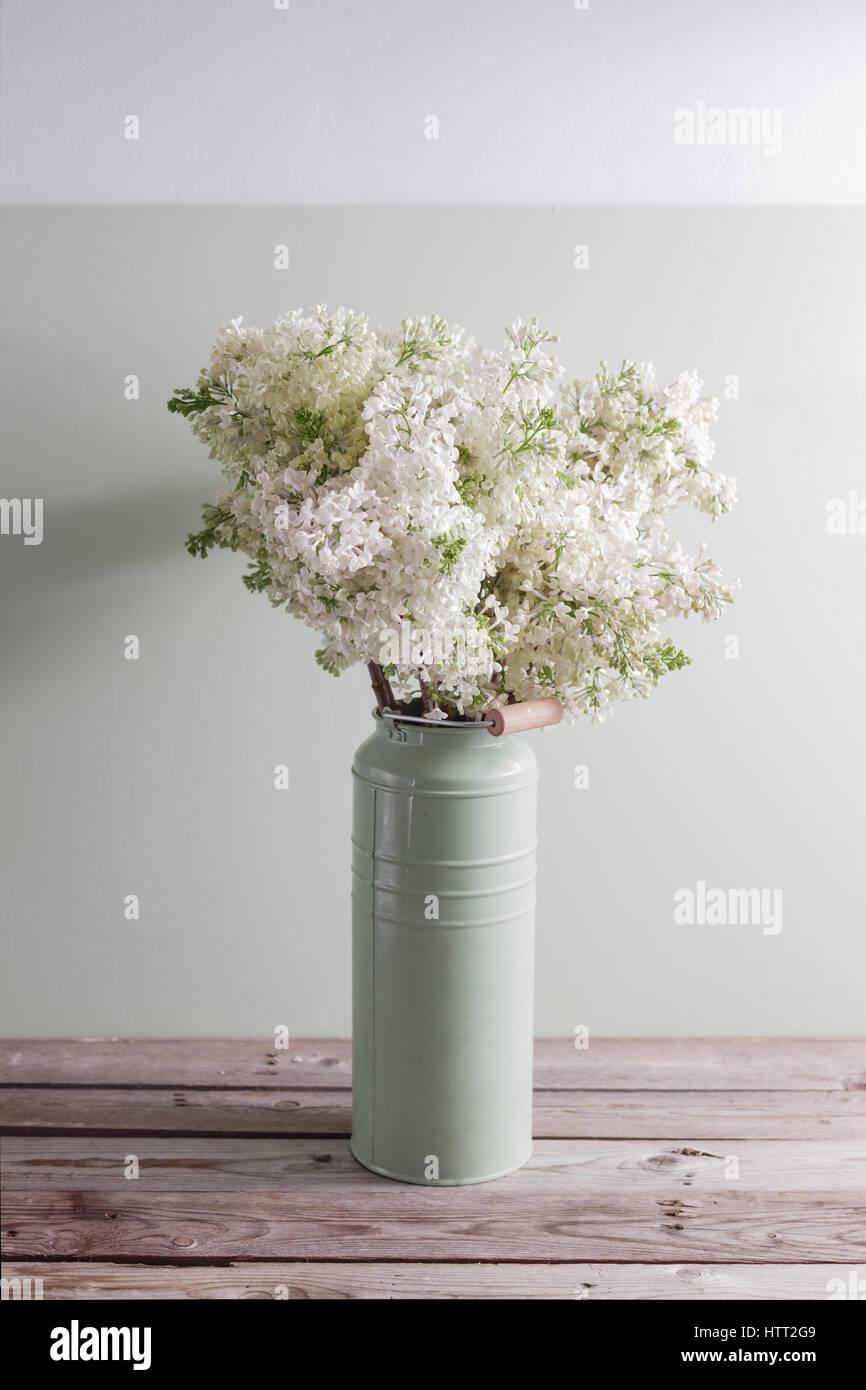 White flowers in vases stunning small vase floral white flowers amazing lilac white syringa flowers in vase spring background with white flowers in rustic can on wooden table with white flowers in vases reviewsmspy