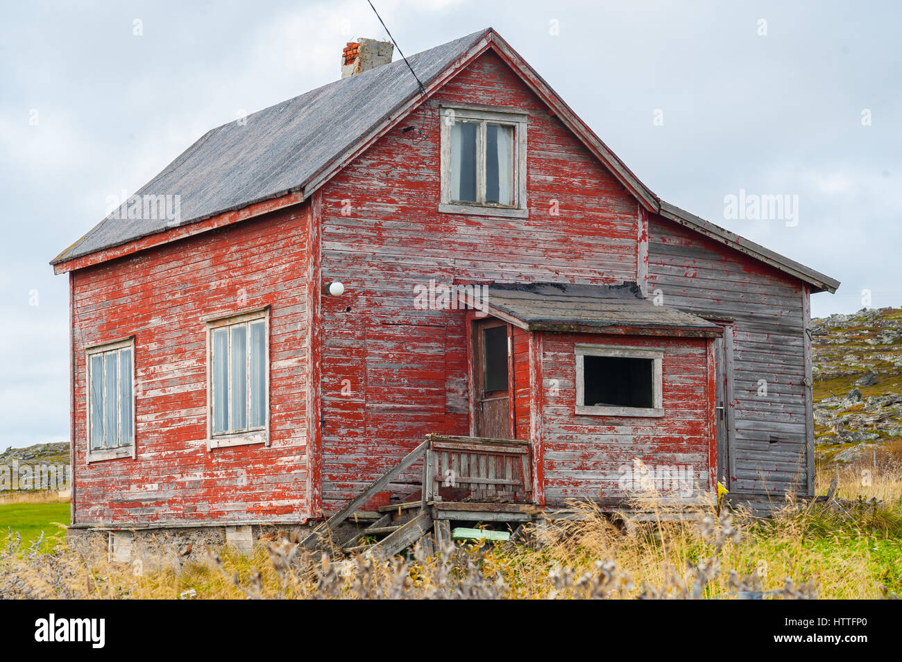 weathered old wooden country house in need of repair stock photo