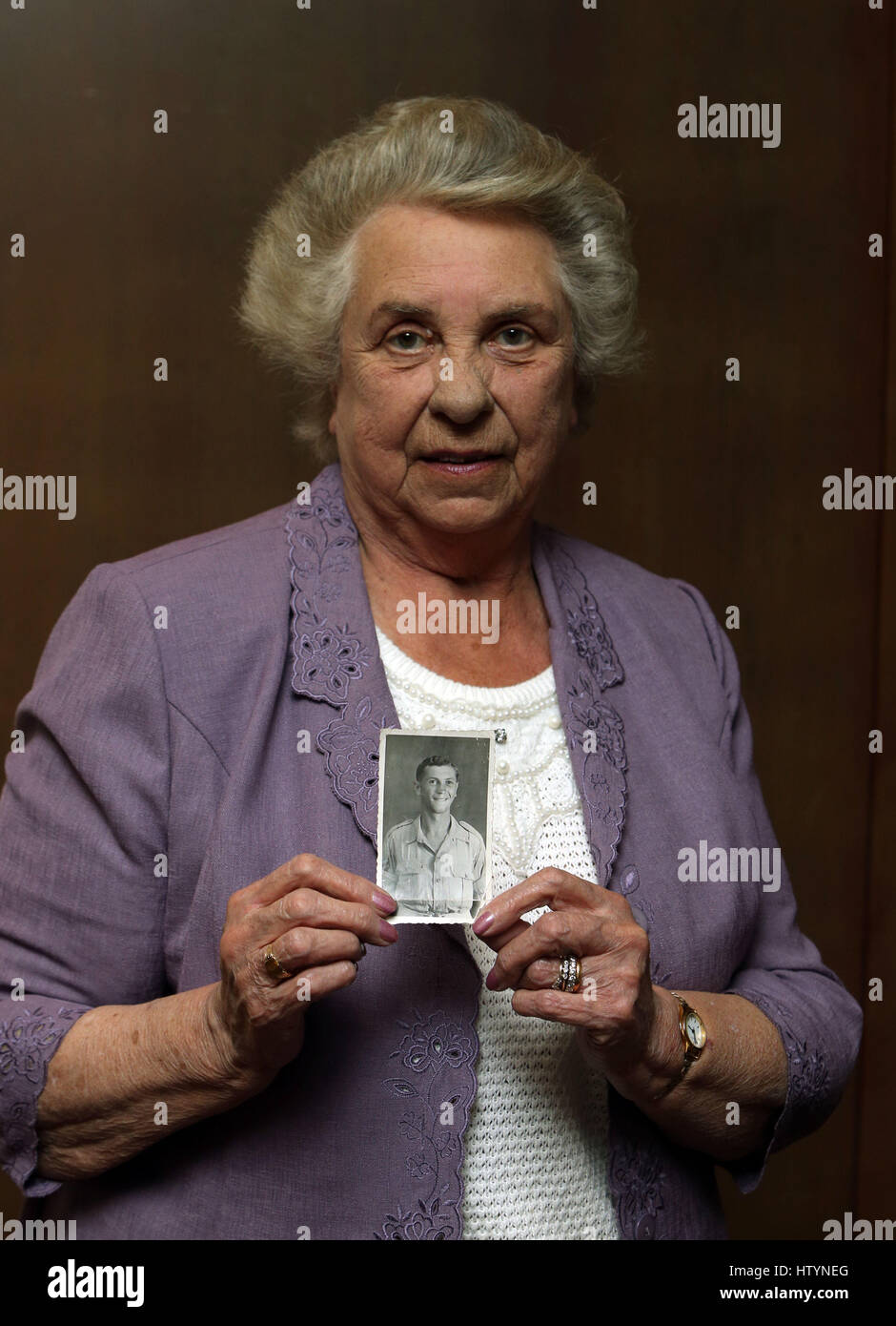 Her Late Night Cravings A Life S Checklist: Alma Williams Holds A Photograph Of Her Late Brother Lance