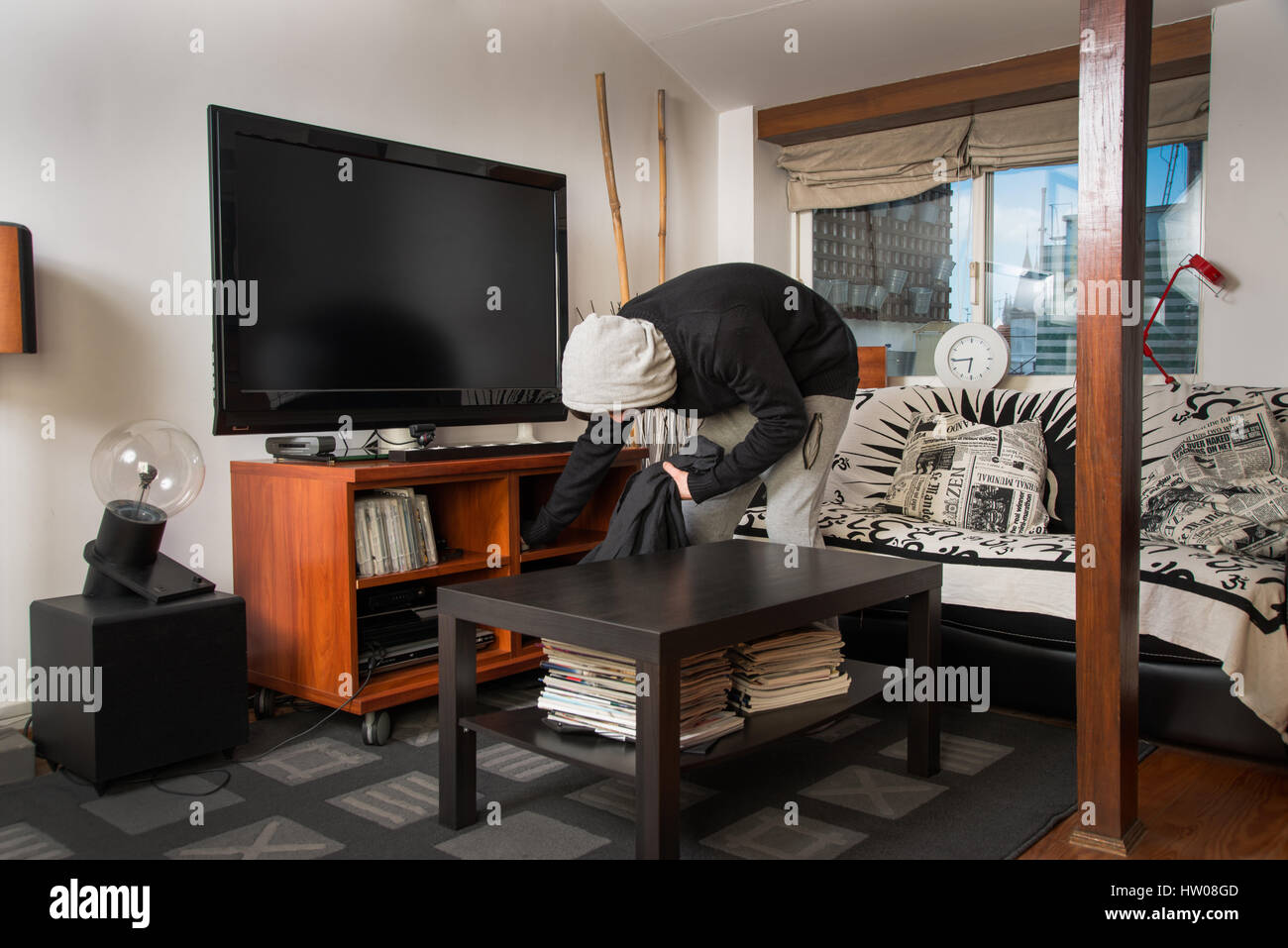 Stock Photo Burglar Robbing A House Burglar Stealing Stuff In A Living Room