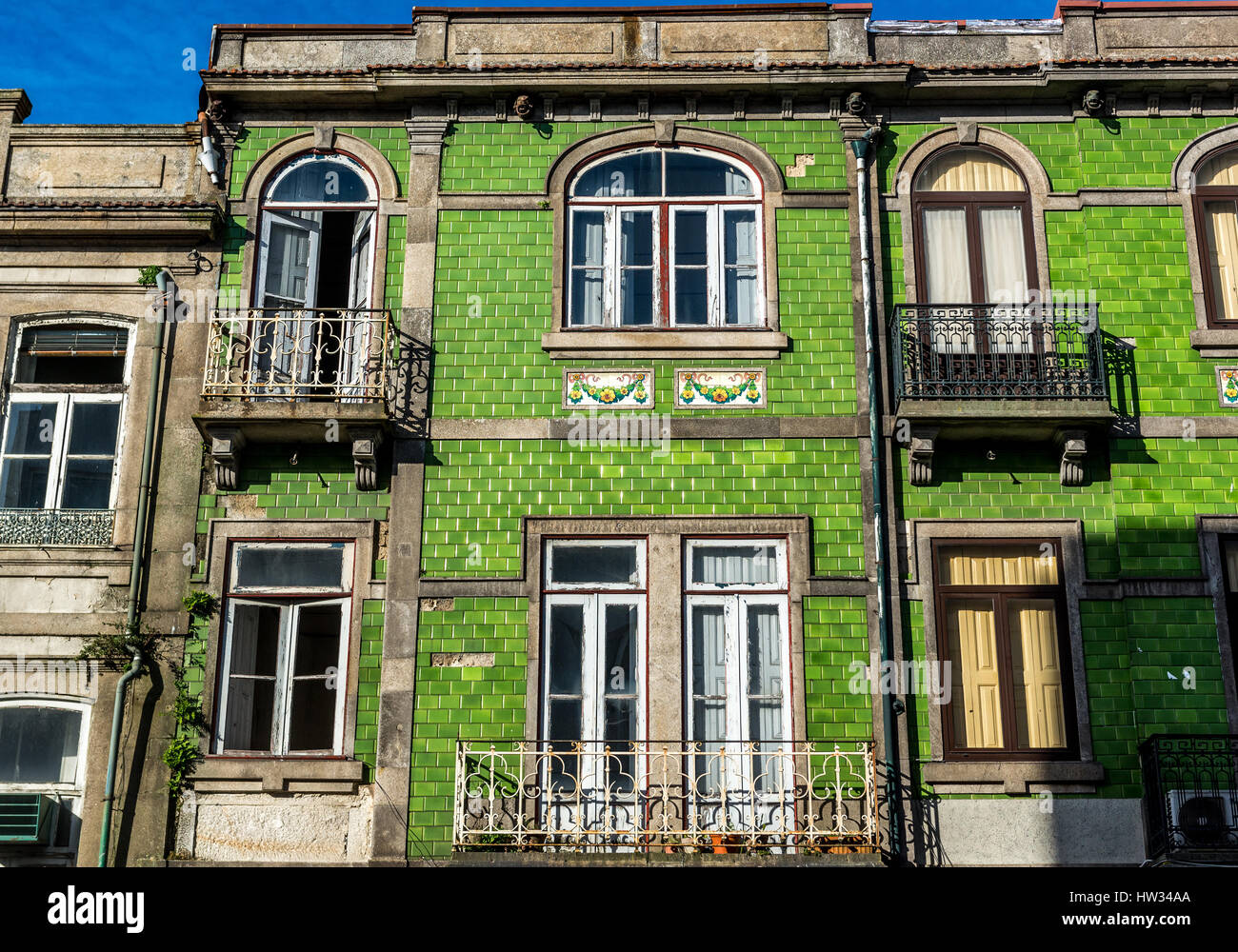 Green azulejo ceramic tiles on residential building in porto city green azulejo ceramic tiles on residential building in porto city on iberian peninsula second largest city in portugal dailygadgetfo Choice Image