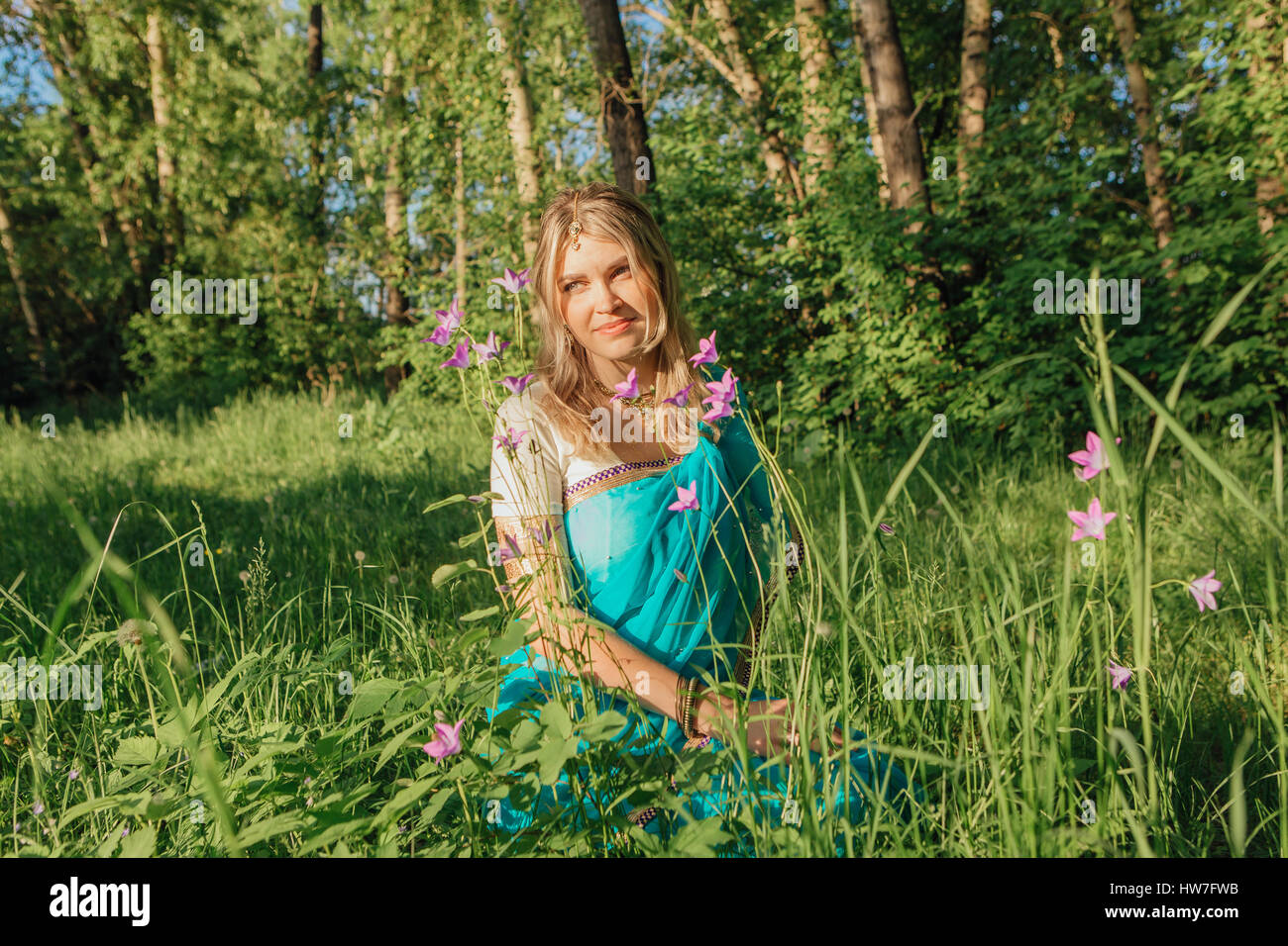 Beautiful European Woman In Traditional Indian Sari With Flowers In