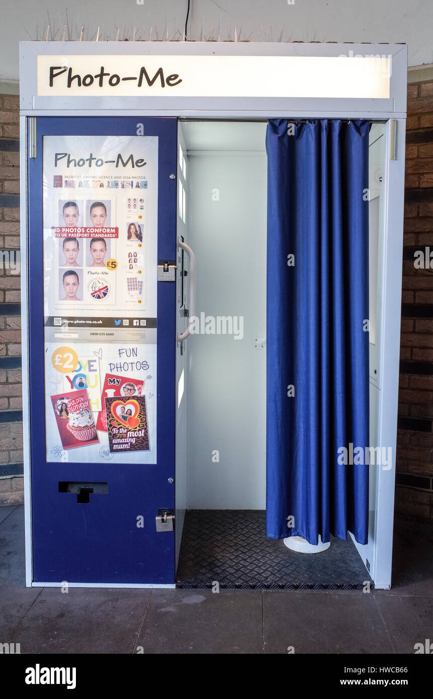 how to take a good passport photo in a booth