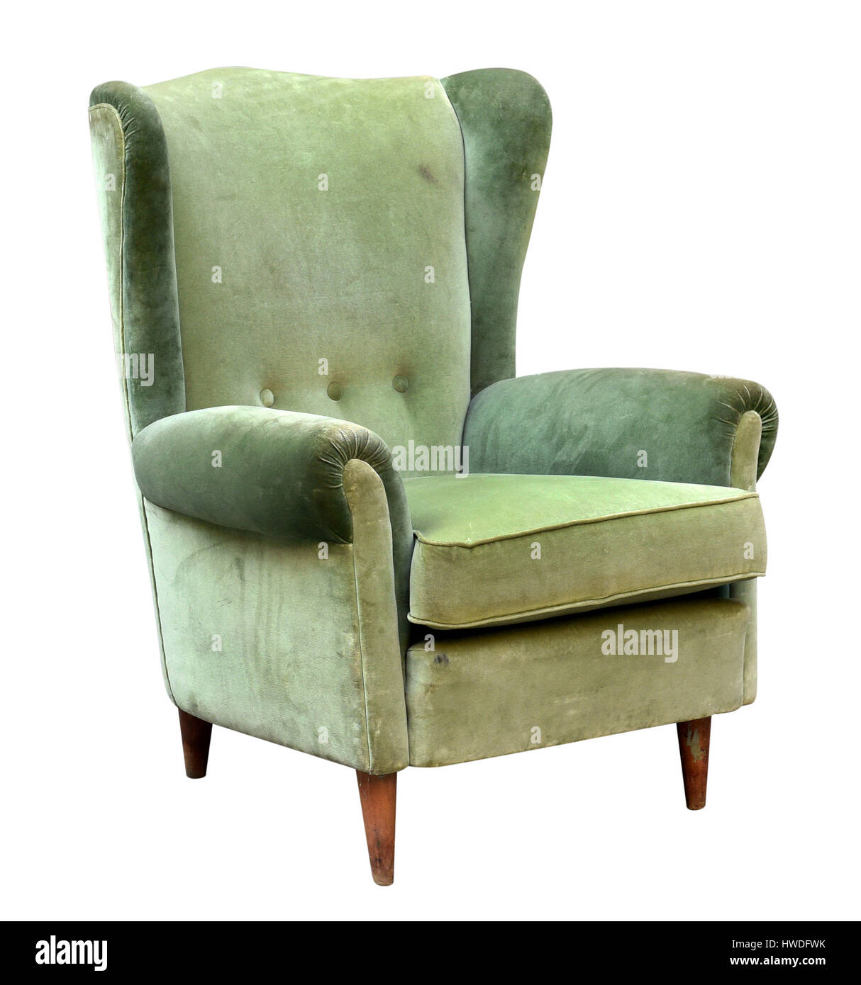 Vintage Upholstered Green Velvet Armchair With A High Wing Back Isolated  Over White In A Three Quarter View