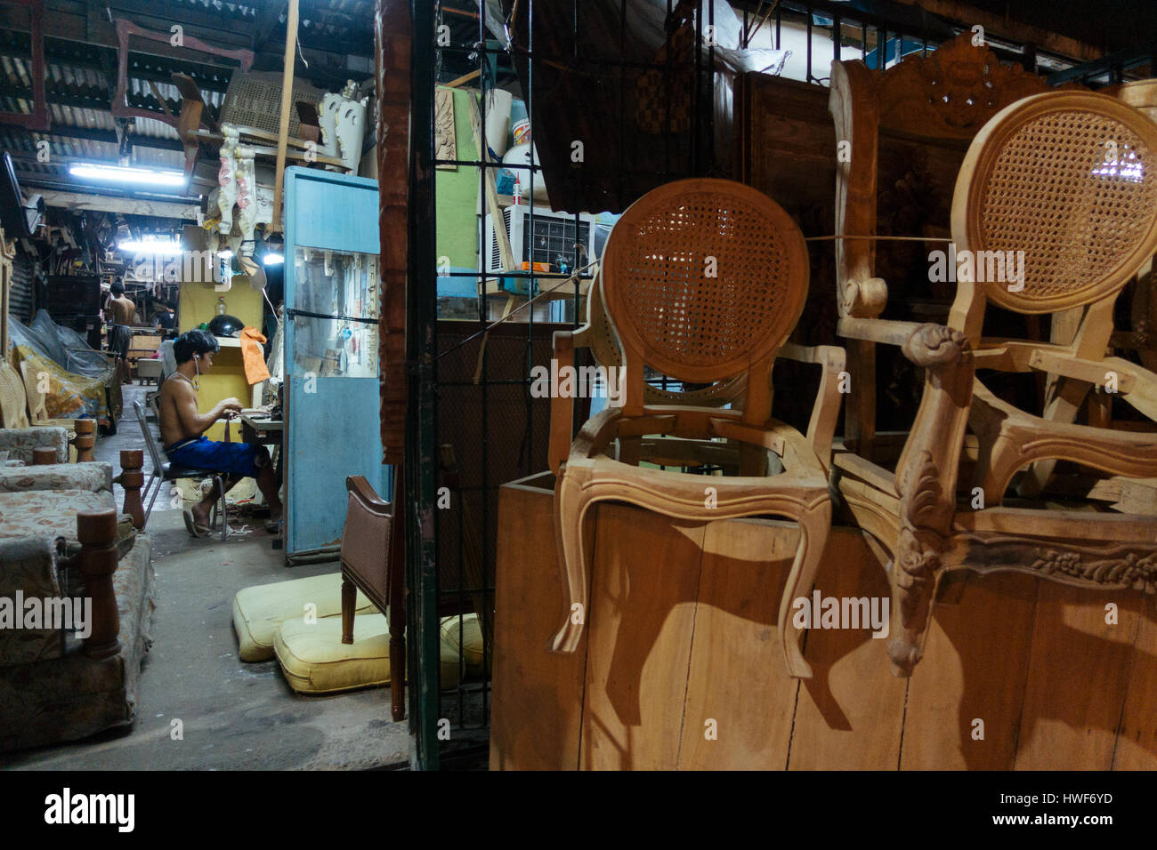 Manila,Philippines   Jan 13, 2017: Young Filipino Working At The Evening In  A Furniture Shop In Quezon City, Manila, Philippines