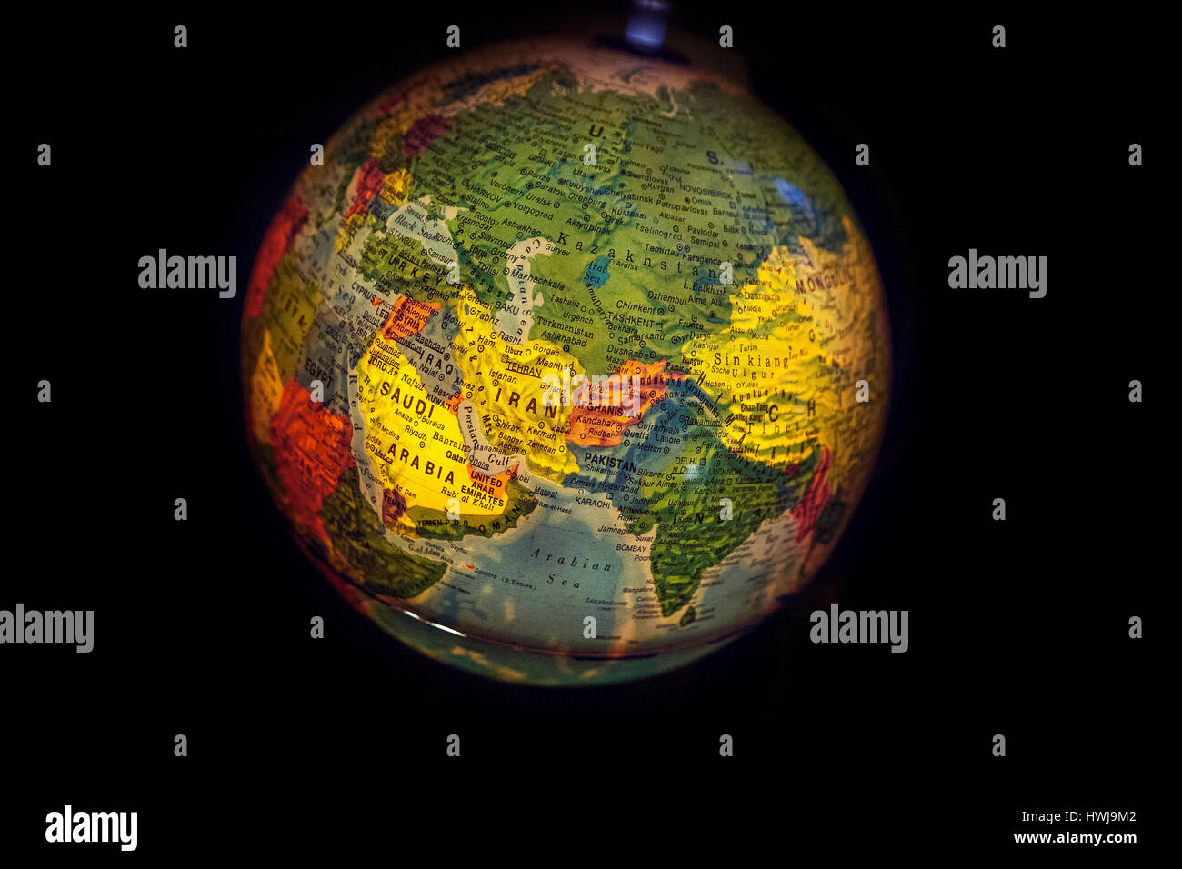 World Map Globe Ball. close up of old fashioned world globe a ball shaped map lit from within  focusing on ASIA INDIA USSR ARABIA CHINA