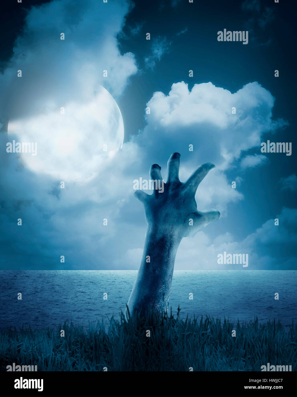 Zombie hand coming out of his grave. Halloween concept Stock Photo ...