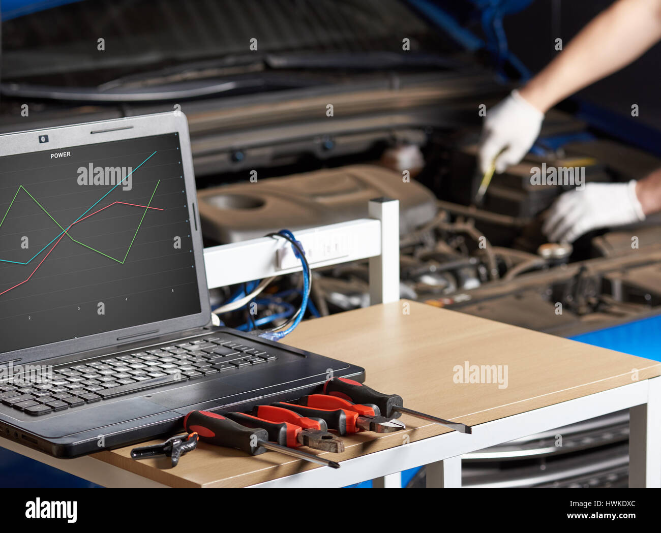 Computer diagnostic of modern car. Mechanic checking
