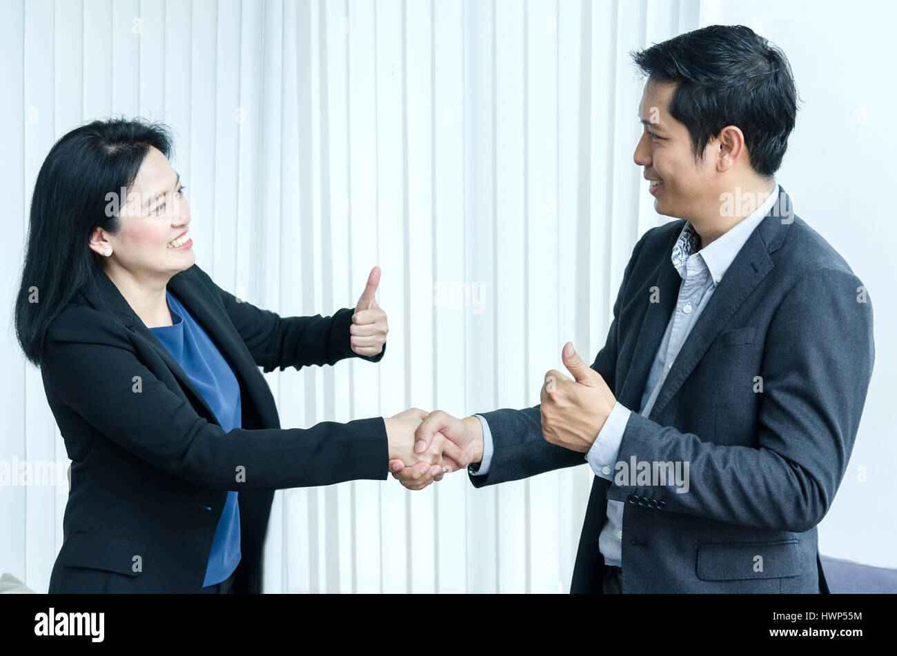 Business people handshake greeting deal at work photo free download - Success Business Team Concept Asian Woman And Man Handshake And Showing Thumbs Up