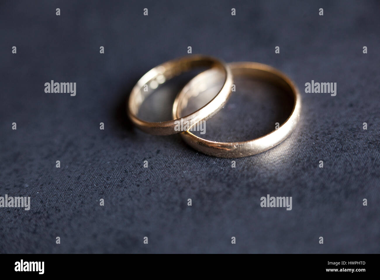 Gold Wedding Rings On Dark Background