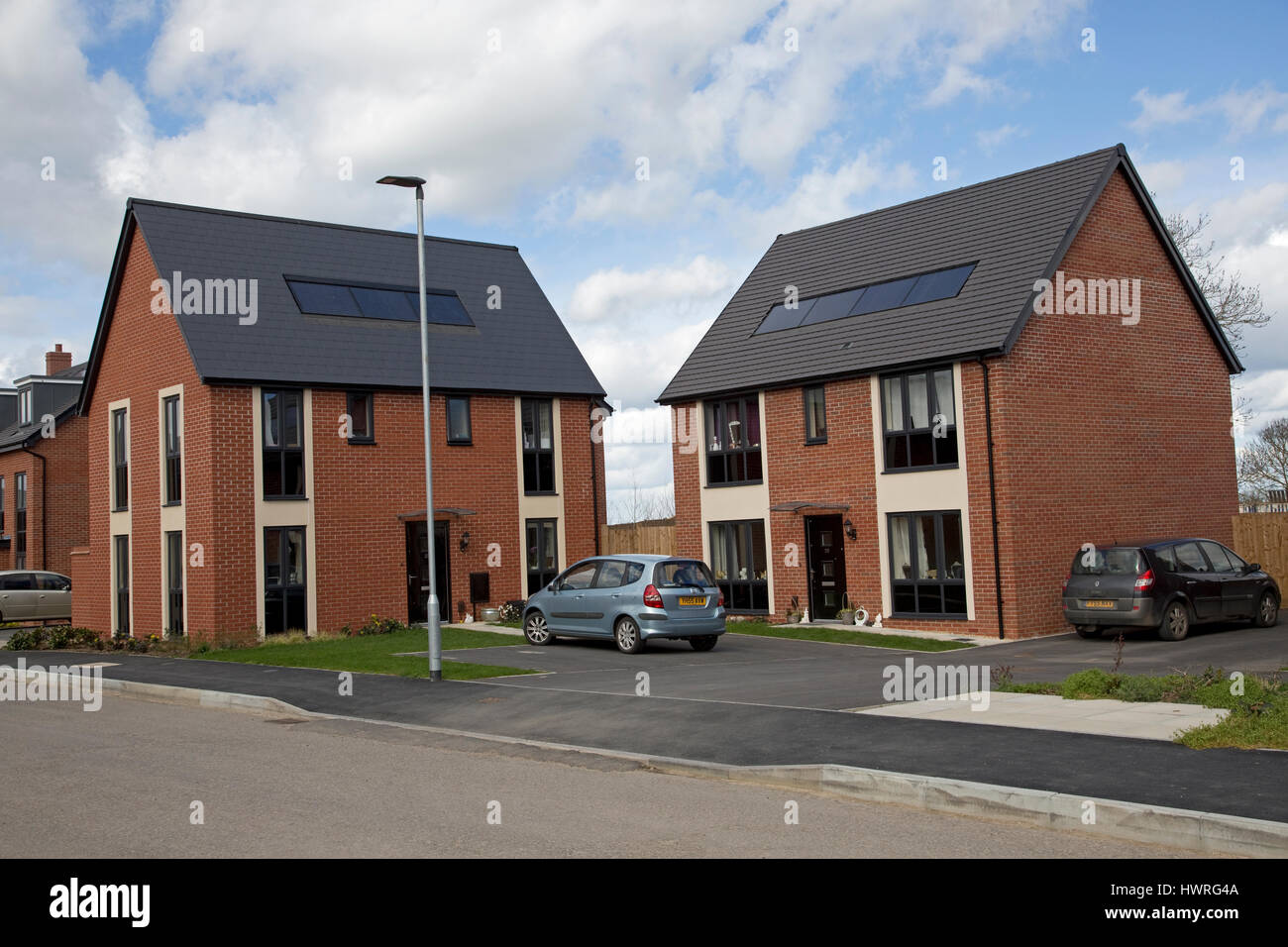 New red brick houses all with solar black pv panels for All brick homes