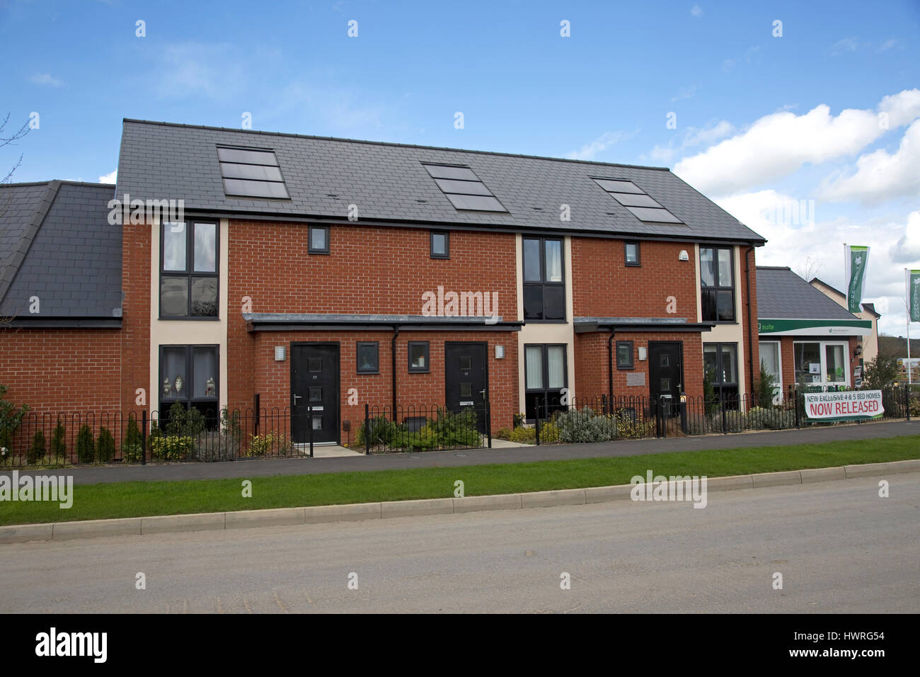 New red brick terraced houses all with solar black pv for New terrace house