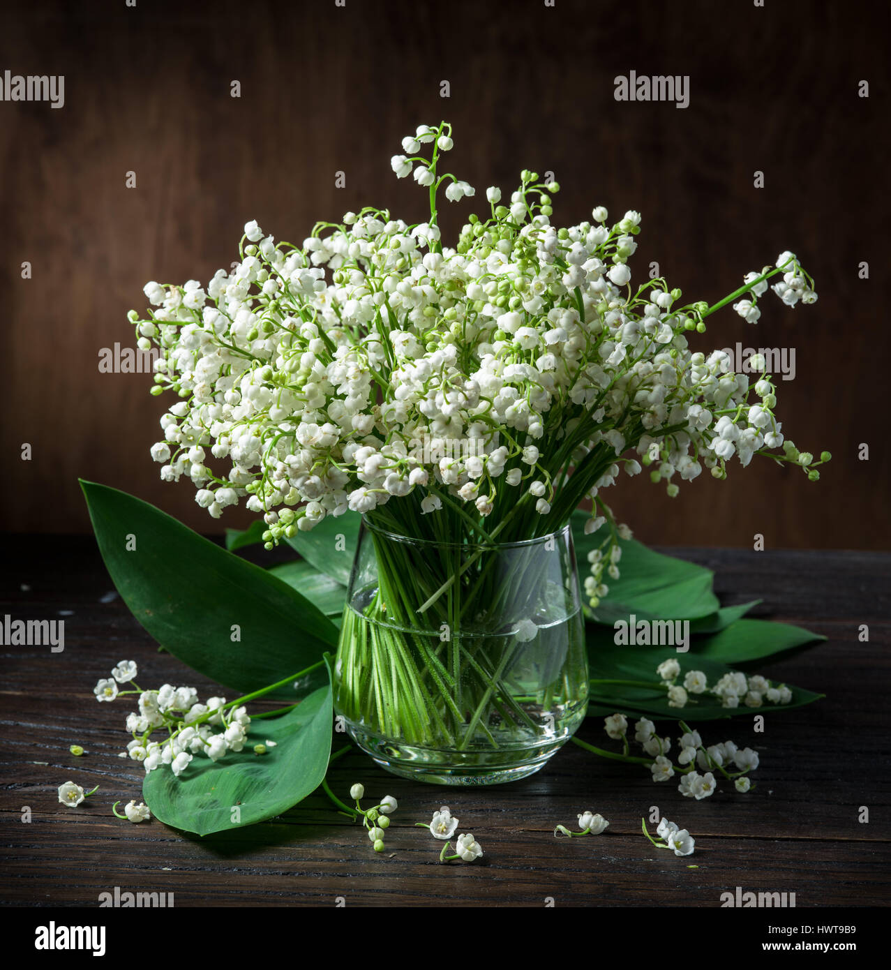 Lily of the valley bouquet on the wooden table stock photo lily of the valley bouquet on the wooden table reviewsmspy