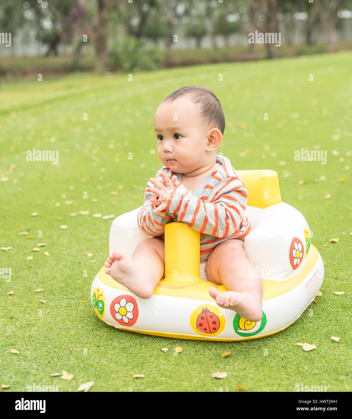 Baby sitting in the park when family taking outdoor picniche baby sitting in the park when family taking outdoor picniche acting sawaddee that mean greeting in thailand kristyandbryce Choice Image