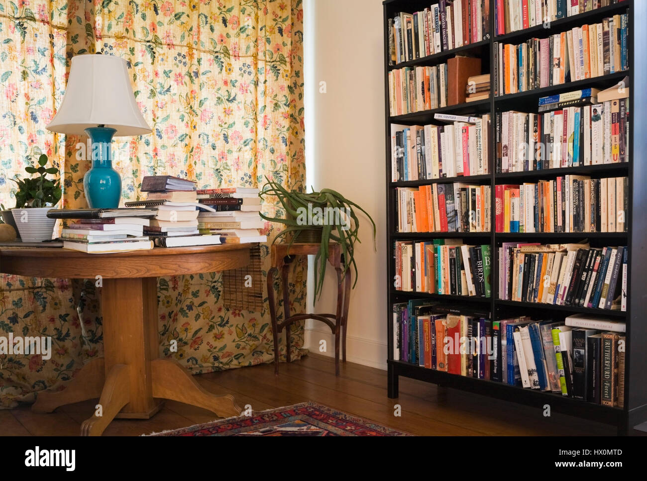 White library room with bookcase and books on round table for Classic house books