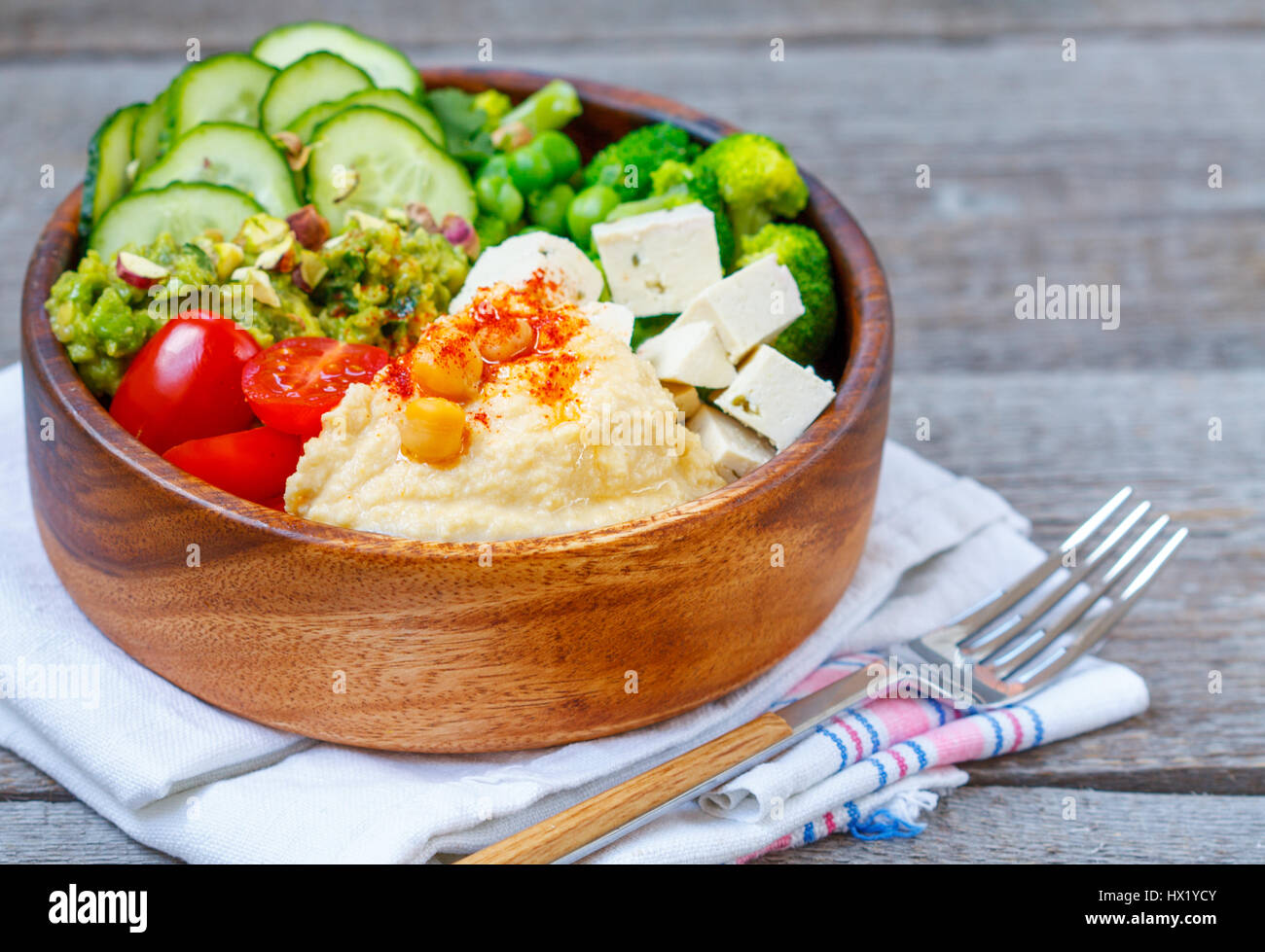 Bowl of bright healthy vegan lunch: vegetable salad with ...