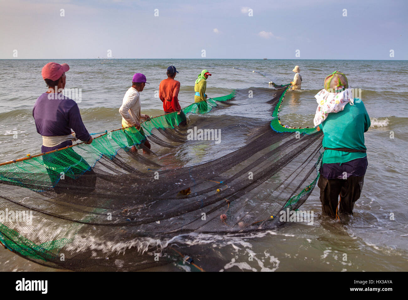 A group of filipino fishermen haul their seine fishing net for Fisher fish chicken indianapolis in