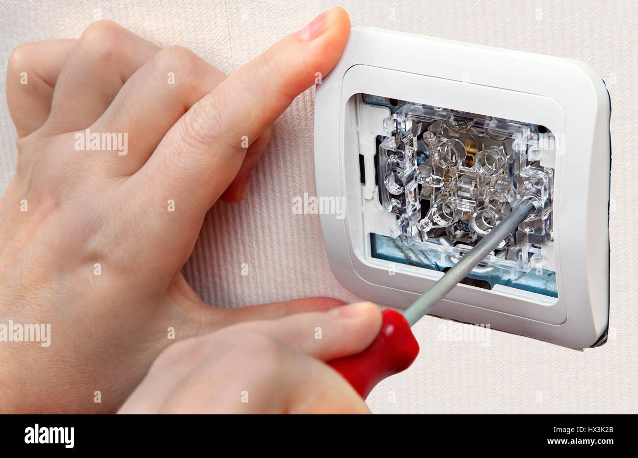 Install wall light switch, close-up of wiring electrician hand ...
