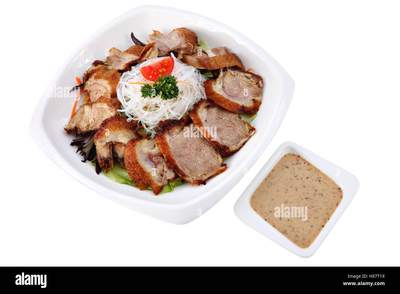 Beijing Duck Asian Cuisine Chinese Dish Peking Duck Slices Of Of Roast Duck On A White Plate With Rice Noodles And A Cup Of Sauce Isolated On Wh
