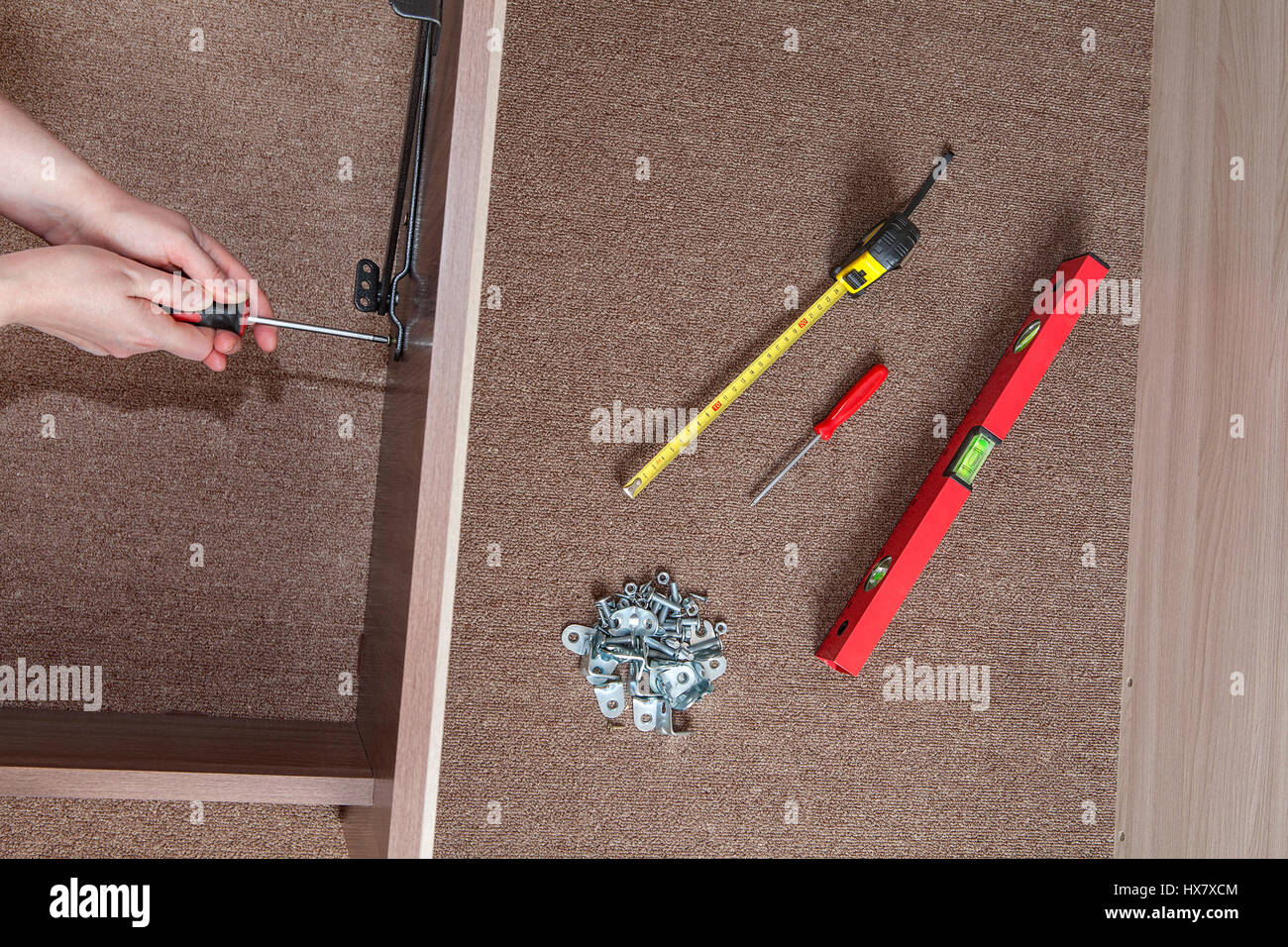 Bed Frame Assembly Furniture Builder Hands Fix The Screw Using A - Furniture nearby