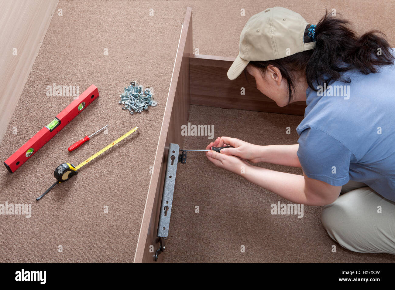 Self Assembling Furniture At Home, Women Putting Together Self Assembly  Furniture.