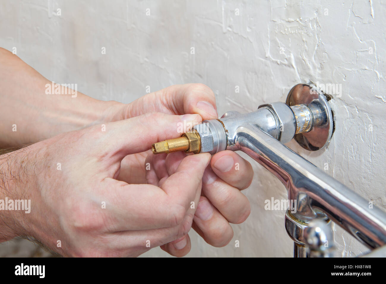 Two handle kitchen faucet repair, close-up plumber hands ...