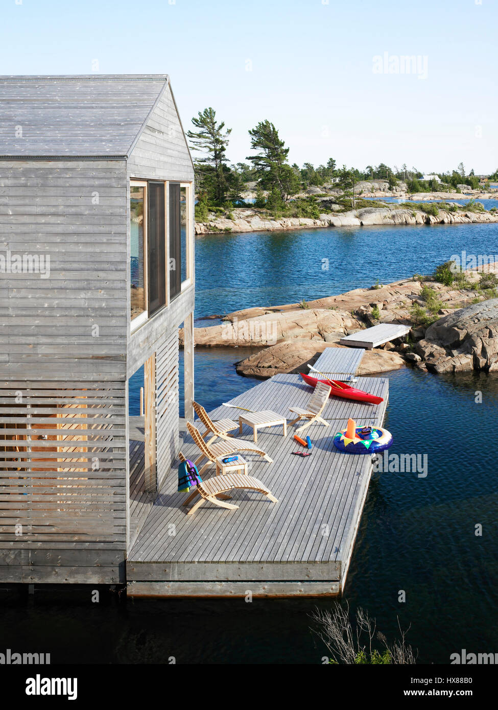 Exterior View Of The Deck Below The Dining Room. Floating House, Private  Island, Georgian Bay, Lake Huron, Canada. Architect: MOS Architects, 2007
