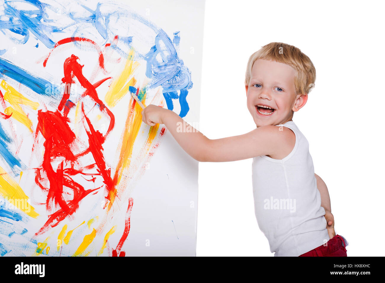 little messy kid painting with paintbrush picture on easel education creativity school preschool studio portrait over white background - Picture For Kid Painting