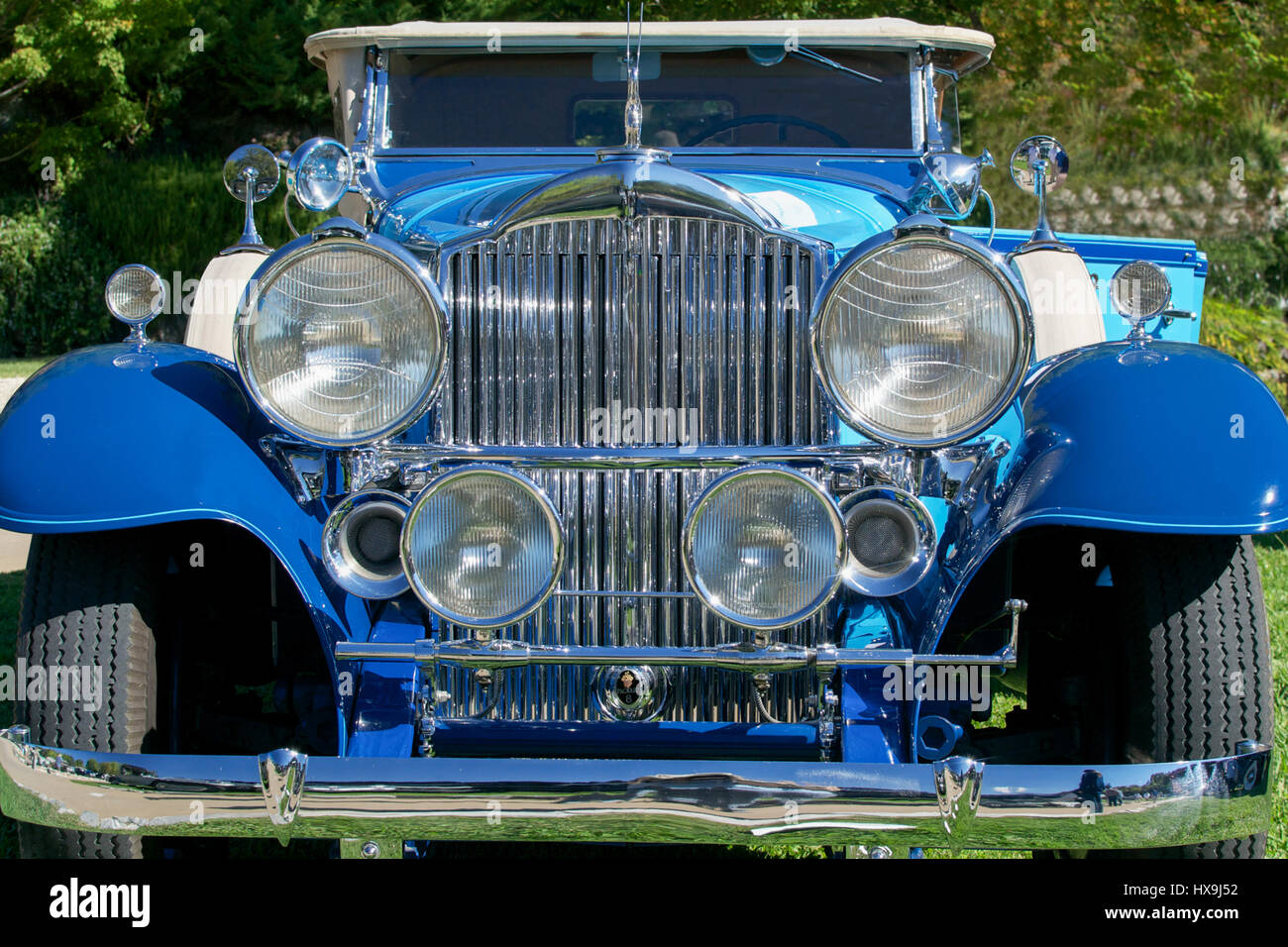 Detail of the front of a vintage car, blue 1932 Packard 902 sport ...