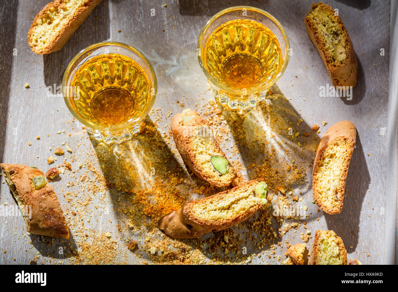 Italian cantucci with Vin Santo on old wooden table Stock Photo ...