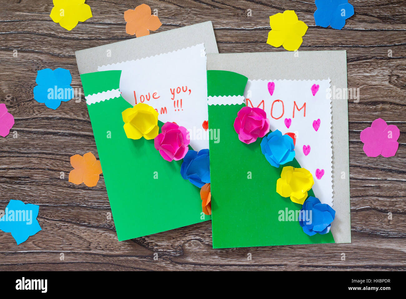 A child is holding a greeting card with flowers on mothers day a child is holding a greeting card with flowers on mothers day childrens art project craft for children handmade craft for children kristyandbryce Gallery