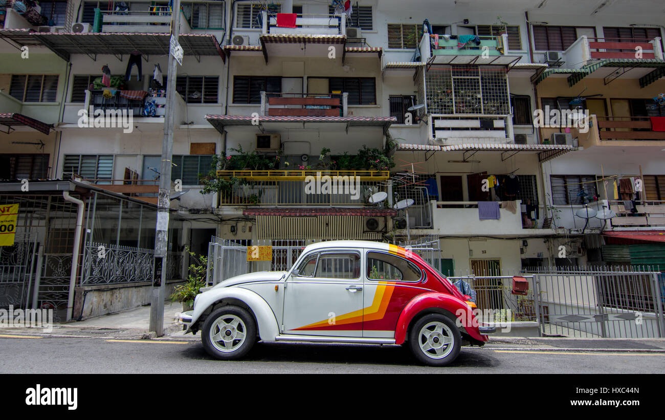 Side On View Of A Well Maintained VW Beetle Parked In Residential Street Apartments Kuala Lumpur