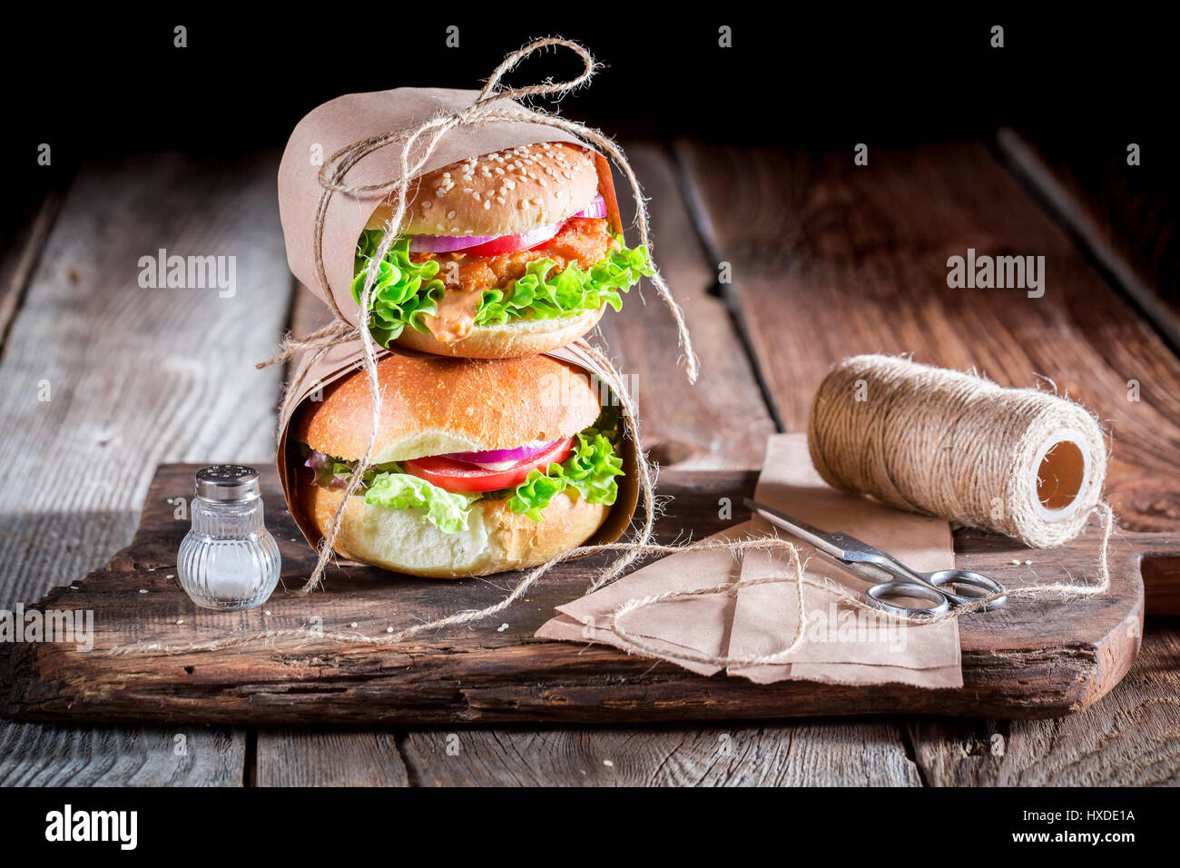 Homemade takeaway burger wrapped in paper Stock Photo: 136750022 - Alamy