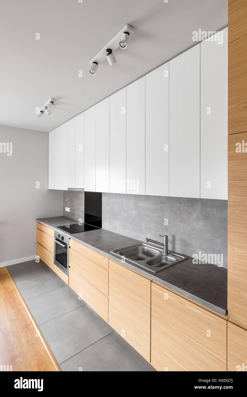 contemporary kitchen furniture with long grey countertop and  - contemporary kitchen furniture with long grey countertop and modernkitchenware