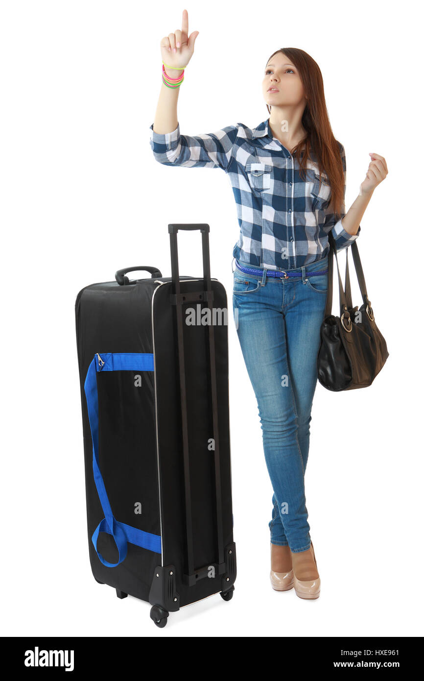 Teen girl 16 years old, with a big, black travel bag on wheels ...