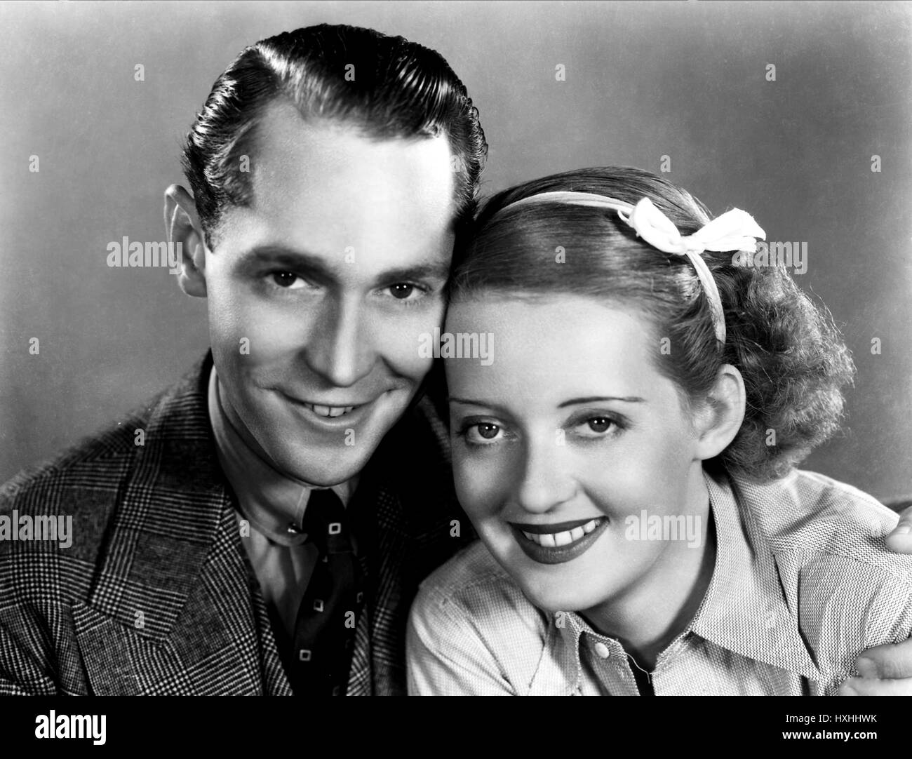 Allan as lucie manette colman had long wanted to play sydney car - Franchot Tone Bette Davis Dangerous 1935 Stock Image