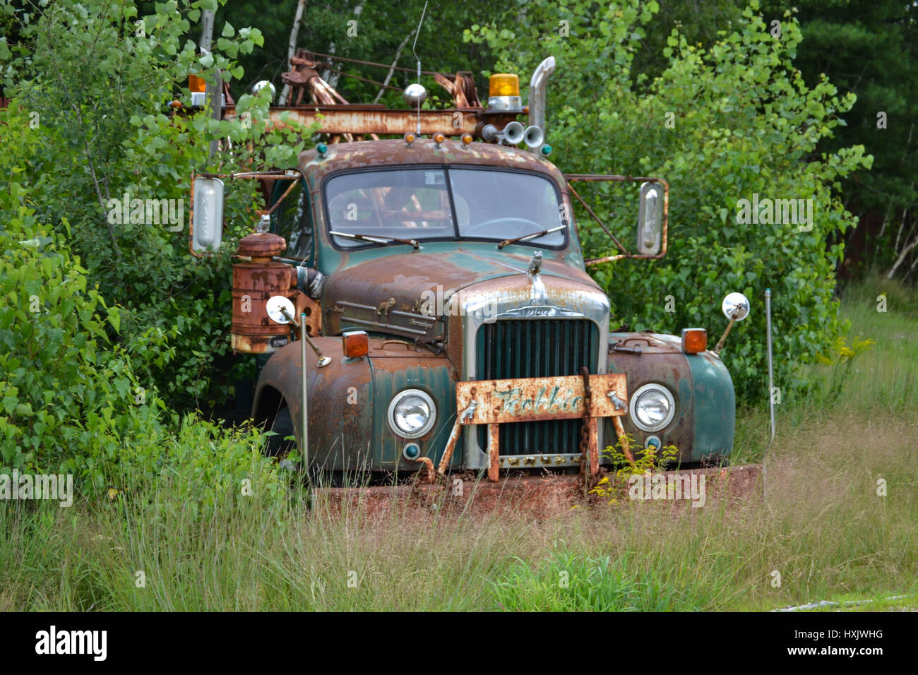 old mack tow truck on the side of the road Stock Photo, Royalty ...