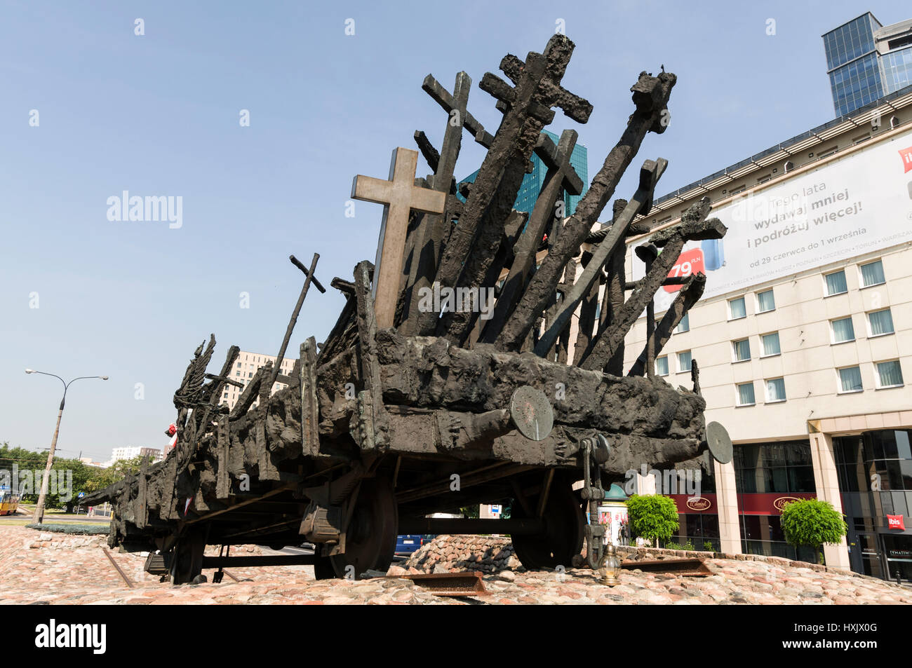 the bronze cast monument of a rail truck full of crosses