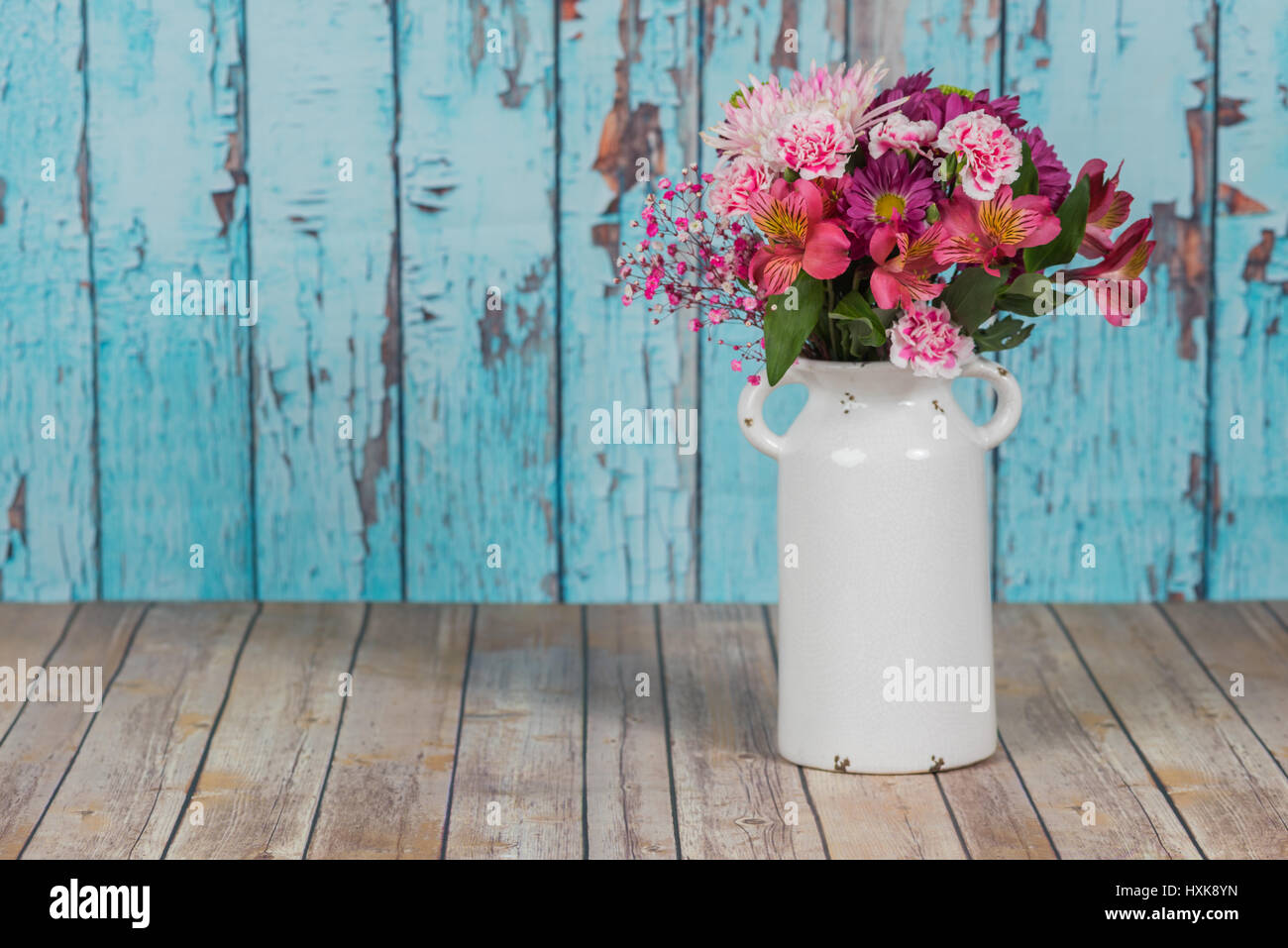Flowers in a vintage white vase with cracked paint background flowers in a vintage white vase with cracked paint background reviewsmspy