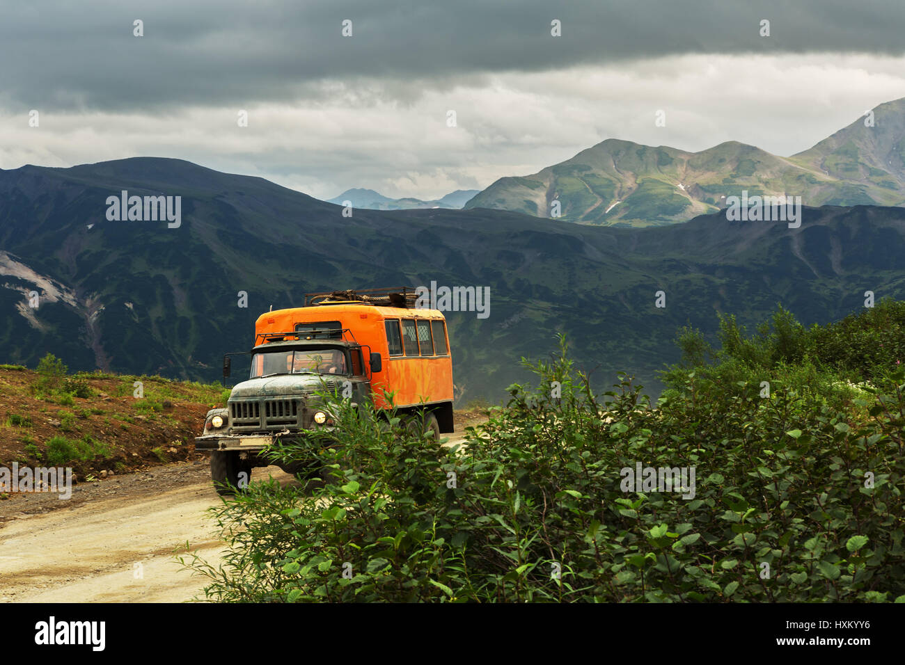 Old off-road big car rides through the Viluchinsky pass Stock Photo ...