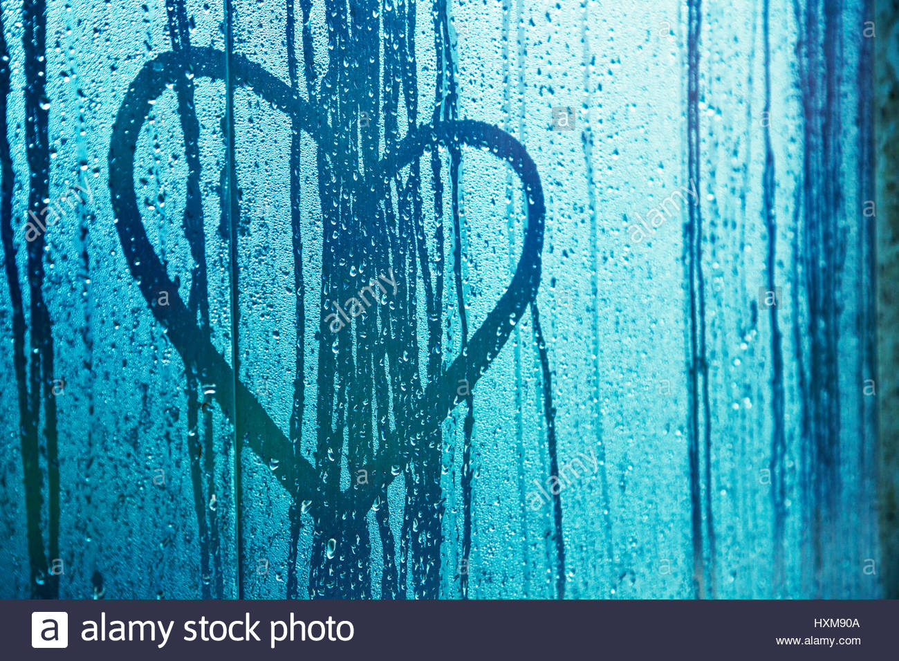 Water drops with love heart symbol on window glass blue filter water drops with love heart symbol on window glass blue filter effect used selective focus used biocorpaavc Image collections