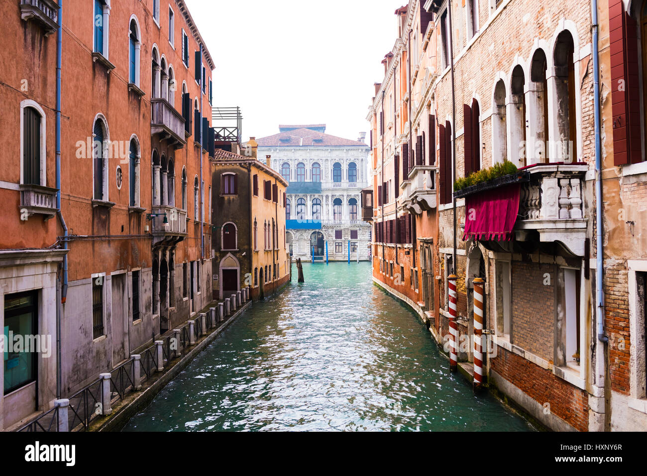 Water Canal And Venetian Buildings In Its Typical