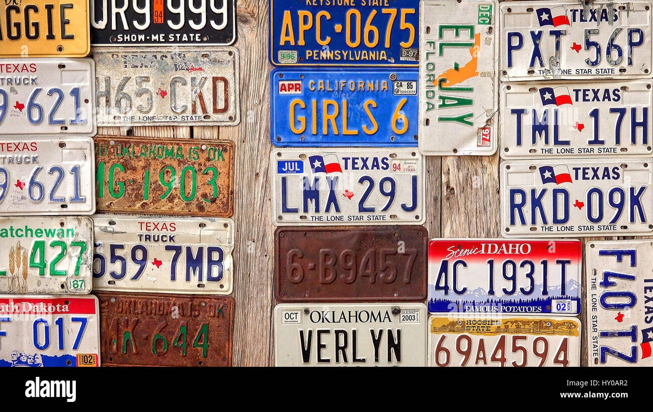 Old license plates are displayed on a wooden barn in Luckenbach ...