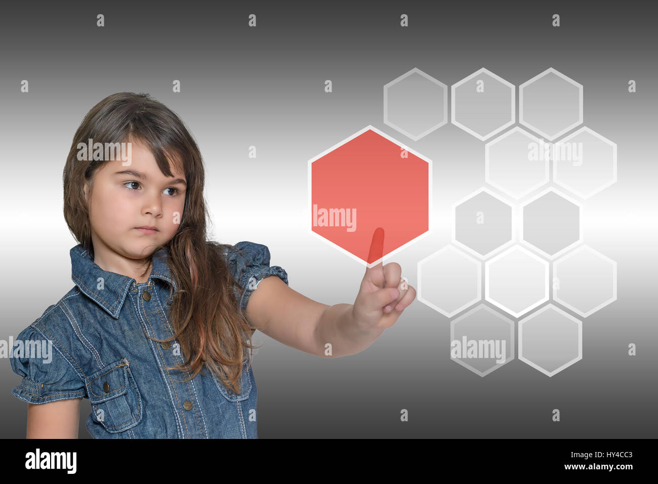 Pensive little girl is touching the transparent red pentagon Stock ...