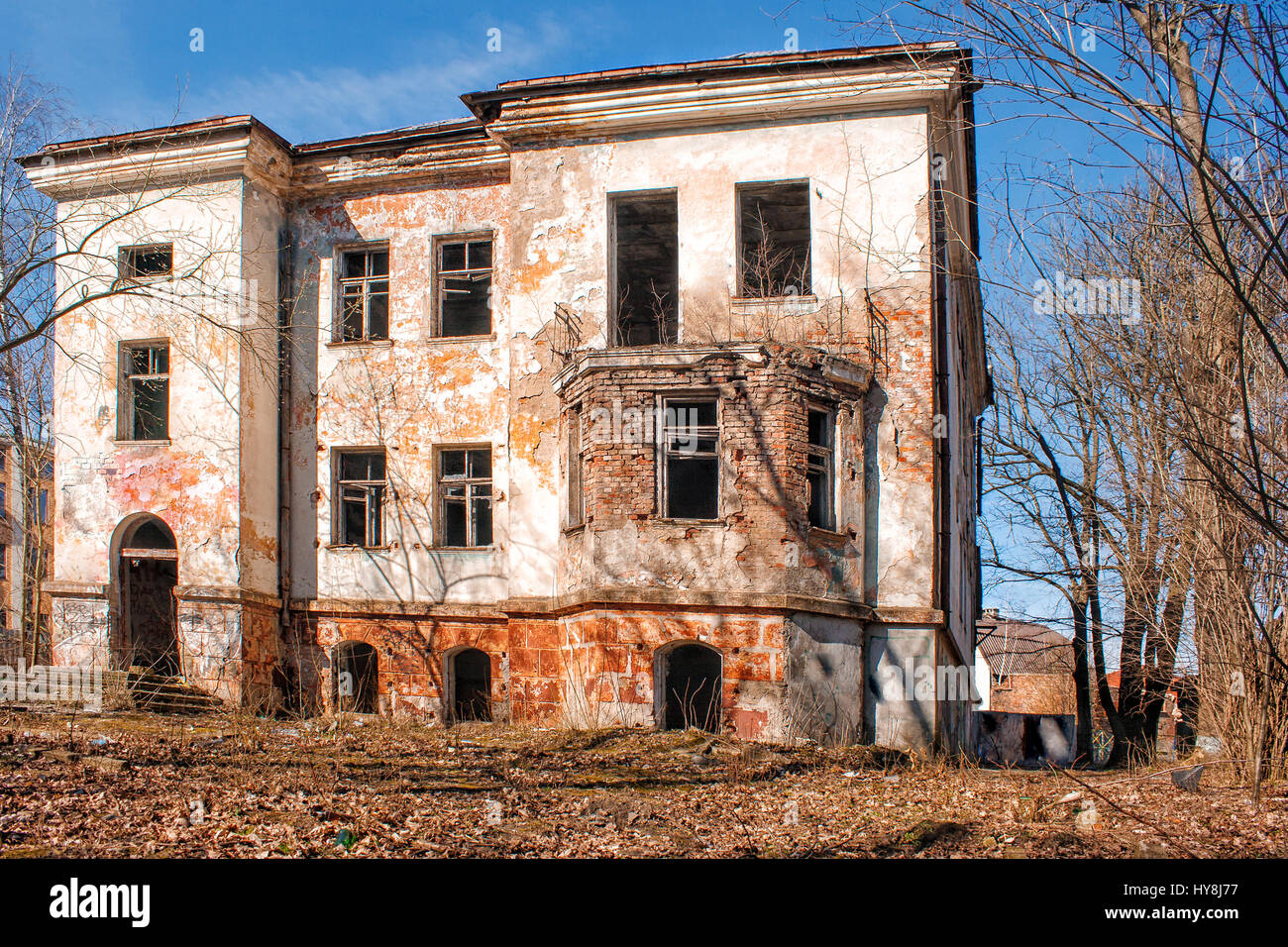 old abandoned house in the city on sunny spring day Stock ...