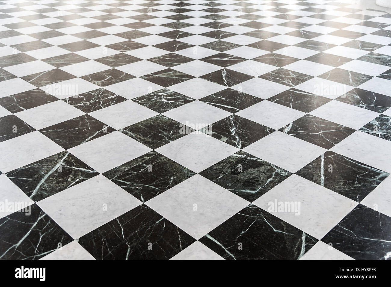Black And White Checkered Marble Floor With Sunlight Stock
