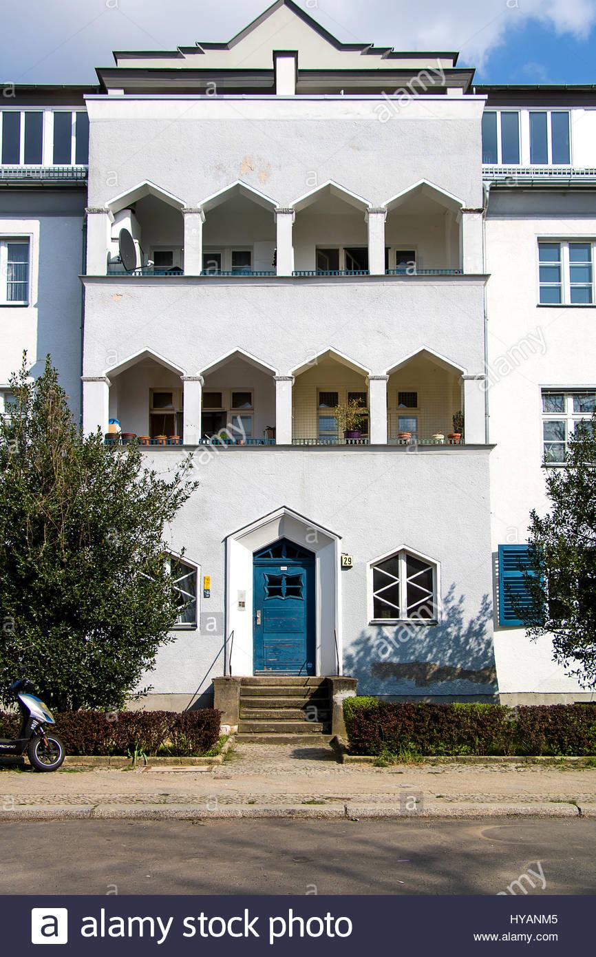Stock photo urban housing area krugpfuhlsiedlung berlin neukölln britz city housing estate housefront with white light blue facade blue house front