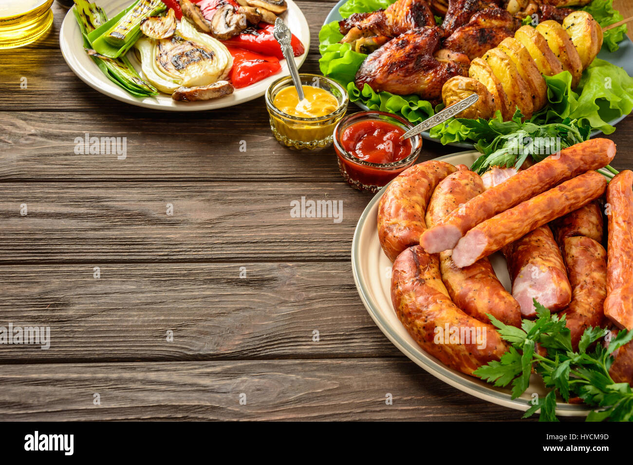 Dinner table with food - Dinner Table With Variety Food Fried Chicken Wings Sausages Grilled Vegetables In A
